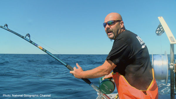 GLOUCESTER, MASS.- Captain Dave Marciano calls out for assistance to help keep his bluefin on the line and bring it aboard the Hard Merchandise. (Photo Credit: Pilgrim Films & Television)