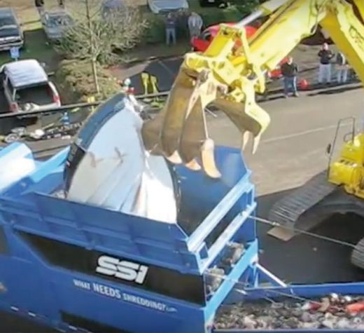 Mobile shredders like this one reduce fiberglass boats to a product that can be easily transported, and possibly re-purposed. Photo Courtesy SSI Shredding Systems.