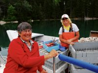 Photo by David BuckmanThe mate Leigh, and lobsterwoman Dianne Ames of Vinalhaven Island, catch up on the past yearÕs news and events.