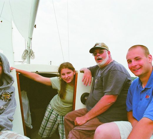 "Ryan, Kate, Jim and Steve Humbert aboard Elfin, the Humbert's ""tweener"" boat, an O'day 22. Photo courtesy Pam Humbert"
