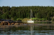 Photo by David BuckmanA boat at anchor in The Cows Yard off Head Harbor Island, Maine.