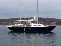 Good Buddy as I first found her in early January, fenders out, sail cover off, as though her former owners had fled.