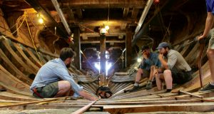 Photo courtesy Mystic Seaport MuseumMayflower II shipwrights use a batten to ensure new components match what's already there.
