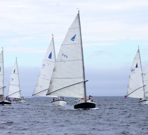 A Nonsuch fleet racing, their unmistakable wishbone rigs -- a concept lifted from windsurfing -- making them immediately identifiable.Photo courtesy Sue Cornell