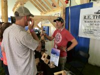R.E. Thomas owner Ben Dinsmore talks to customers regarding his line of marine hardware. Photo by Bob Muggleston