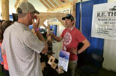 R.E. Thomas owner Ben Dinsmore talks to customers regarding his line of marine hardware. Photo by Bob Muggleston