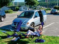 """Photo by Christopher BirchThe author's daughter, Heidi, and dog, Pedro, relax outside their """"vessel."""""""