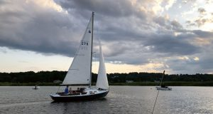 Photo by Tom BelcherGood Buddy glides through a serene Essex Harbor. Wind and waves? She likes those, too, as I recently discovered.