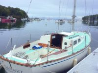 Photo courtesy Ben SteeleSpencer and Tess on the bow in Seal Bay, Maine (above), and Gannet waiting for her boom during commissioning. The aqua-colored decks have a distinctly 1960s feel.