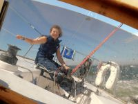 Photo by Mark BarrettDiana at the helm. Seasickness? Fear of heeling? Remarkably they were non-issues during the indoctrination process.