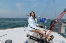 Newly minted girlfriend/sailor Diana diligently checks, while driving, mainsail trim aboard Student Driver, the author's J/24. Photo by Mark Barrett