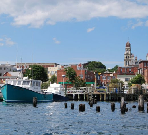 The commercial fishing vessel Miss Carla in Western Harbor, the spire of Gloucester City Hall in the background.