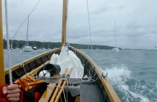 Photo by Michael LongApproaching the boat launch at hull speed, under mizzen alone, with mainsail and jib in a heap forward.