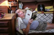 "Photo courtesy Dave RoperThe author in ""hunkered-down"" mode, reading 1/2 hour of every two."