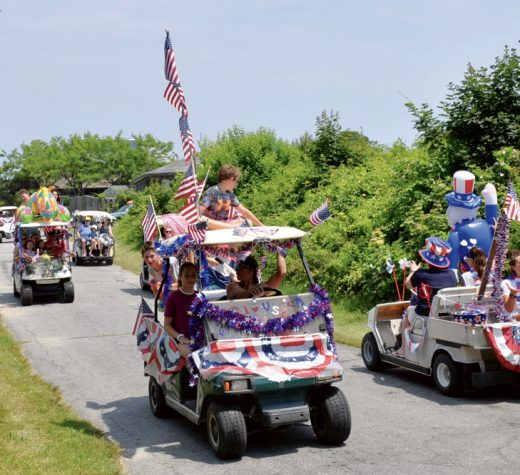 Everyone wants to know when the golf cart parade starts in town because no one can quite remember from last year. Dale, the harbormaster, always knows.Photo by Chris Birch