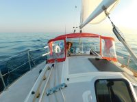Photo by Diana DonahueThe author at Mojo's helm. The boat's small diesel was a welcome change from the outboard on his last boat.