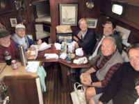 """Photo by David RoperA pre-COVID-19 gathering of The Driftwood Boys. Since confined spaces have been off-limits recently, they've found an alternative way to """"go cruising."""""""