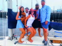 """Photo courtesy Ali WischThe winning """"Wannabe Pirates"""" aboard Seabiscuit post-race. L-R - Brittany (holding the team mascot, Rowan), Isaac, Ali, Mike, and Jason."""