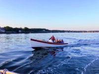 Photo by Jack FarrellNo need for speed. Bob Eger and friends are having a wonderful time cruising in his 25 hp Handy Billy launch.