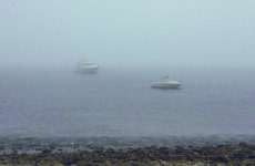 Photo courtesy Tim PlouffTegoak, the author's 21-foot Sea Ray, at anchor in the fog.