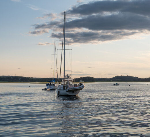 The shallow waters of Essex Bay do not keep out all sailboats. The near boat is a Pearson 42 that draws 5 feet 3 inches and the distant boat is Mike Roger's Hunter 34 that draws 5 feet 5 inches. Our boat draws 4 feet 4 inches. Photo courtesy Hamer Shannon