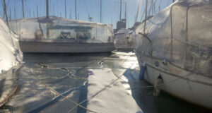 Photo by Ali WischLiveaboard boats secured to each other in their winter slips at Boston Harbor.